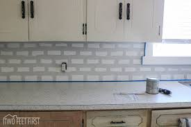 how to put up tile backsplash in kitchen diy cheap subway tile backsplash hometalk