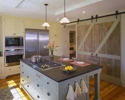barn door for kitchen cabinets barn doors in kitchen country kitchen hutker architects
