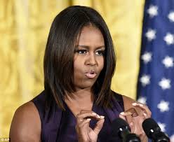 ms obamas hair new cut michelle obama debuts a sleek new hair cut to present the national