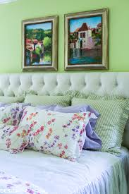 refining the master bedroom with a white tufted headboard