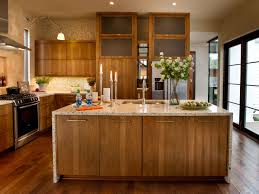 hickory wood cabinetry extends 10 feet to the ceiling in this