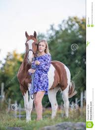in dress with horse stock photo image 57955105