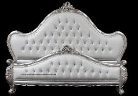 a charles french louis style bed in silver leaf and upholstered in