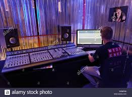 Studio Production Desk by Sound Engineer At The Mixing Desk In A Recording Studio Music