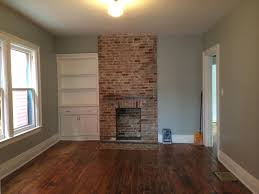 347 massachusetts avenue rehab complete buffalove development dining room with exposed brick new mantle by wrafterbuilt and refinished hardwood floors