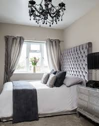 look around this four bedroom 1930s house in manchester the room neutral bedroom with black chandelier and padded headboard