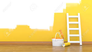 paint roller for a paint and a ladder near a wall of yellow