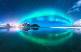 when are the northern lights in norway aurora reflected in water northern lights norway stock photo by