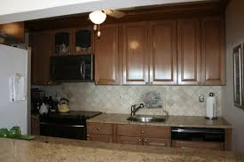 Easiest Way To Refinish Kitchen Cabinets by How To Refinish Kitchen Cabinets With Stain Tehranway Decoration