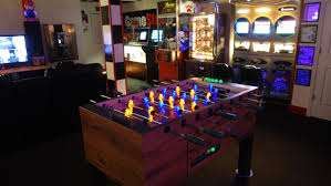 glowing foosball table basement arcade and video game room