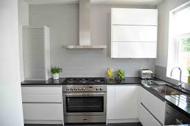 kitchen how to clean white cabinets black countertop galley