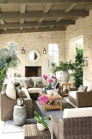 best 25 outdoor living spaces ideas on pinterest outdoor pretty covered porch with chevron rug and pink accents