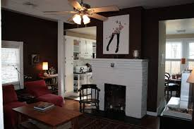 black wall paint with picture also white fireplace and red sofa f