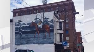 man o war mural being painted on downtown lexington restaurant