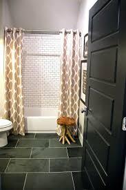 Subway Tile Bathroom Floor Ideas by Black Subway Tile Bathroom Towel Shelves On The Wall White Floor