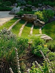 sloped backyard with steps and boulders landscaping your sloped
