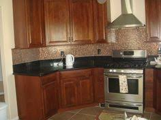 kitchen counters and backsplashes backsplash ideas for black counters with nutmeg cabinets yahoo