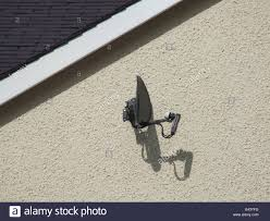 tv satellite dish on council house wall stock photo royalty free