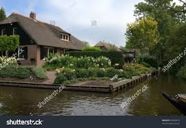 Giethoorn Holland Homes For Sale by House Canal Boat Giethoorn Venice Holland Stock Photo 59470915