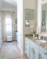 mint green master bathroom painted cabinets and brushed gold