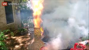 guy uses a leaf blower to turn this outdoor fireplace into a flame