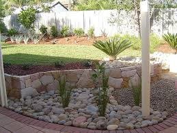 curved edge of yard river rock landscaping ideas google search