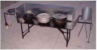 lodge dutch oven table tools and equipment for fire safety texas iron chef