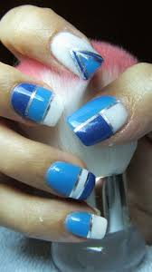 blue and white nails with silver stripes by valkira nail art