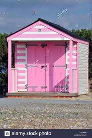 bright pink and white striped beach hut on the popular beach front