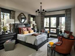 large master bedroom designed with sitting area and wall mounted