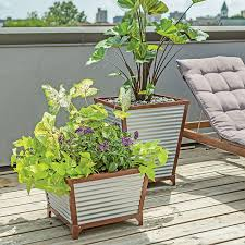 Corrugated Metal Planters by Galvanized Corrugated Metal Self Watering Planters So That U0027s Cool
