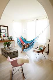 love the idea of putting a hammock in a sunny corner of the living
