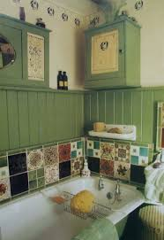 country style bathroom interior with green wainscoting and ceramic