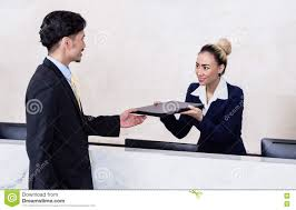 Front Desk Secretary Jobs by Applicant Giving His Documents To Receptionist Stock Photo Image