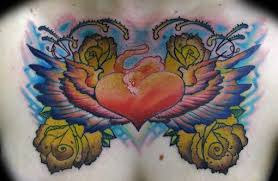 tattoo with wings and surrended with roses jpg