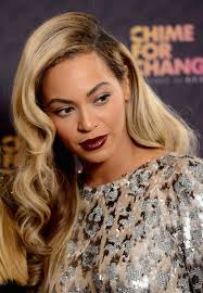 a side part with long hair and a swoop and a cross beyonce knowles deep side parting long hairstyle with waves for