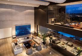 living room white fabric sofa white chanderlier double height