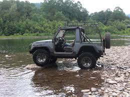 suzuki samurai lifted zuk in the creek with the calmini roof rack cool zuks