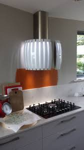 arrital kitchen orange glass splashback falmec hood dee design