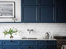 white kitchen cabinets with blue tiles cozy home with a blue kitchen via coco lapine design