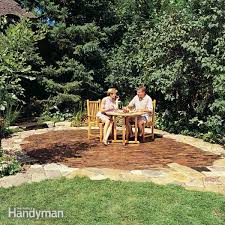How To Regrade A Backyard Build A Stone Patio Or Brick Patio Family Handyman