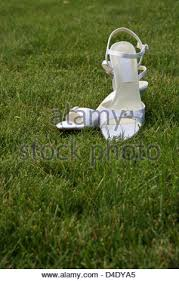 wedding shoes for grass wedding shoes on grass stock photo royalty free image