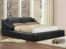 low profile black leather bed frame with low head board and short
