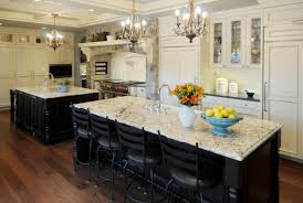 black wooden kitchen island with grey granite tabletop and black