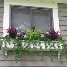 filling window boxes with artificial outdoor plants decorate