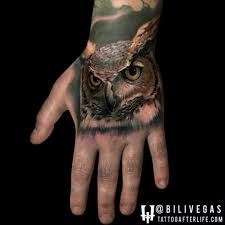 nice and amazing owl face tattoo on hand golfian com