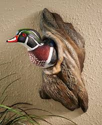 wood duck in tree wall sculpture at simply bovine sculpting