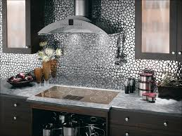 gray grout with white subway tiles helps keep the kitchen from