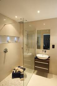 ensuite in neutral porcelain tiles walk in shower aqlcove with