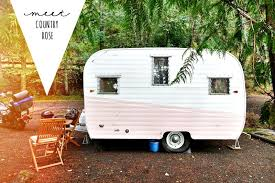 a vintage travel trailer named country rose happiness is